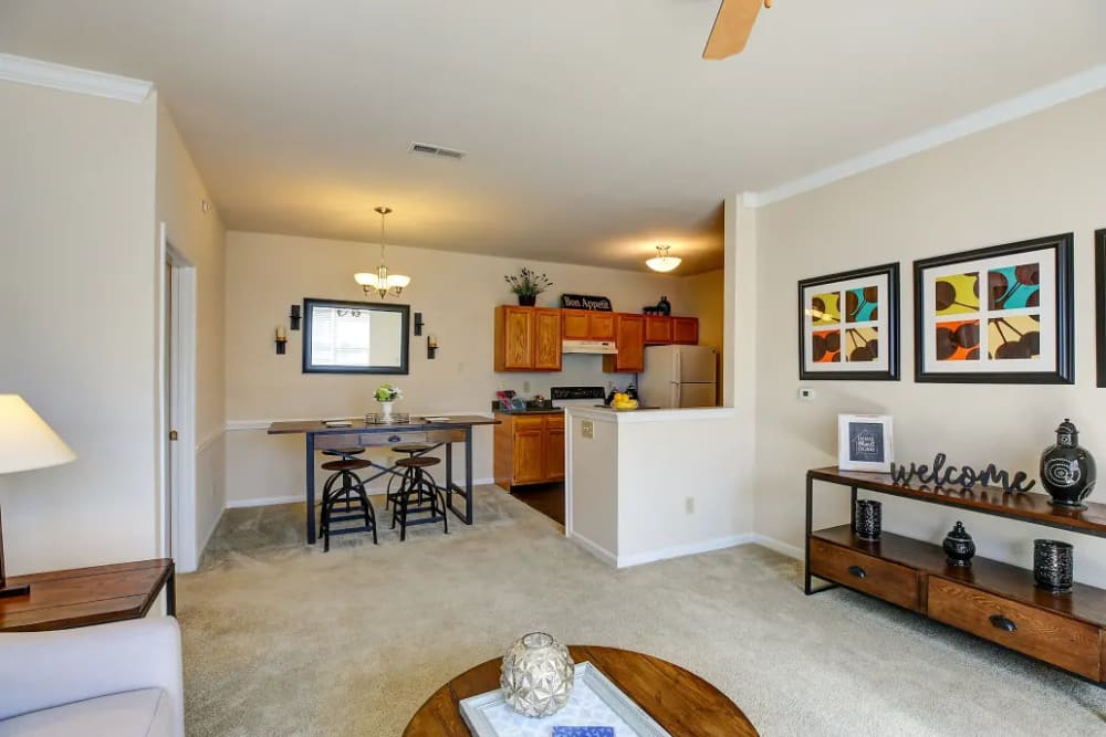 An open floor plan apartment with cozy furnishing at Charleston Pines Apartment Homes in Florence, Kentucky
