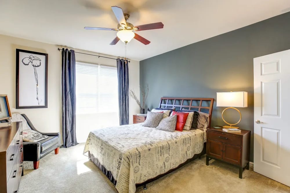 A furnished bedroom in Charleston Pines Apartment Homes in Florence, Kentucky
