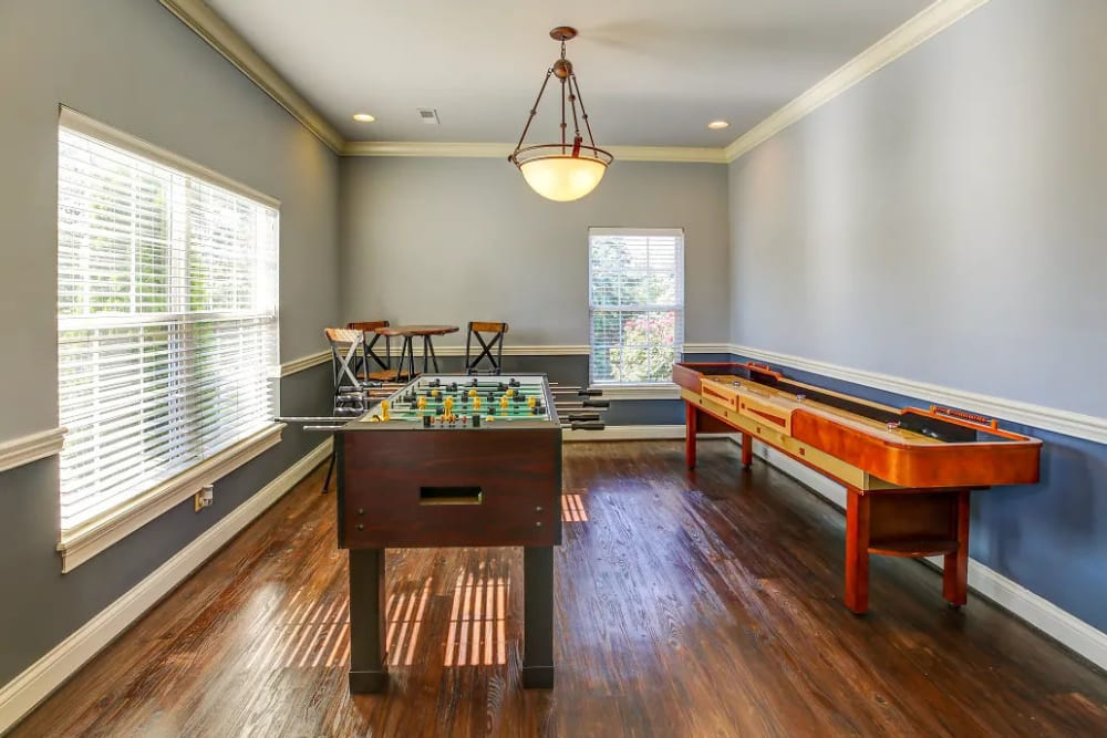 Foosball, shuffleboard and a tall table in the clubhouse at Charleston Pines Apartment Homes in Florence, Kentucky