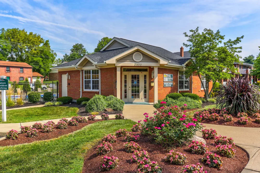 Beautifully landscaped entrance to the leasing office of Four Seasons Apartments in Erlanger, Kentucky