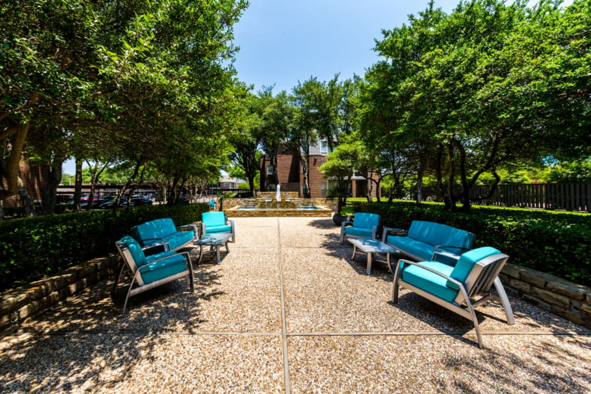 Outdoor water feature with sitting area at Marquis at Legacy in Plano, Texas