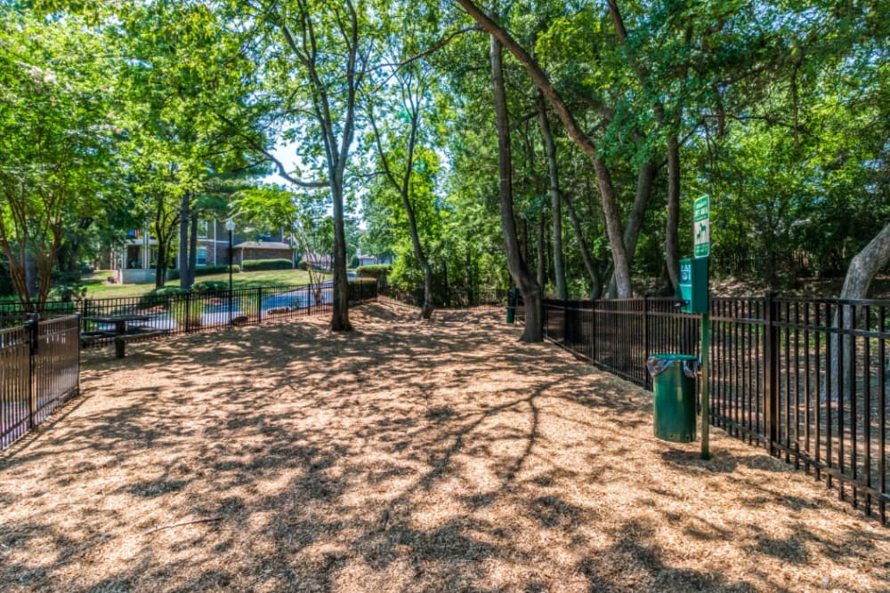 Spacious dog park with pet waste station at Marquis at Carmel Commons in Charlotte, North Carolina