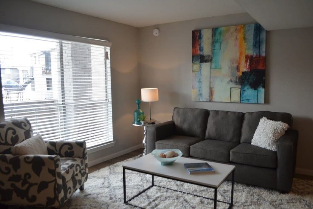 Bayou Parc at Oak Forest offers a spacious living room in Houston, Texas