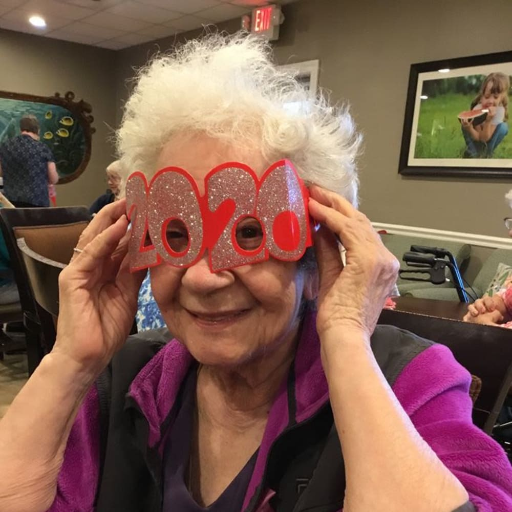 A resident having fun celebrating the New Year at Inspired Living Hidden Lakes in Bradenton, Florida.