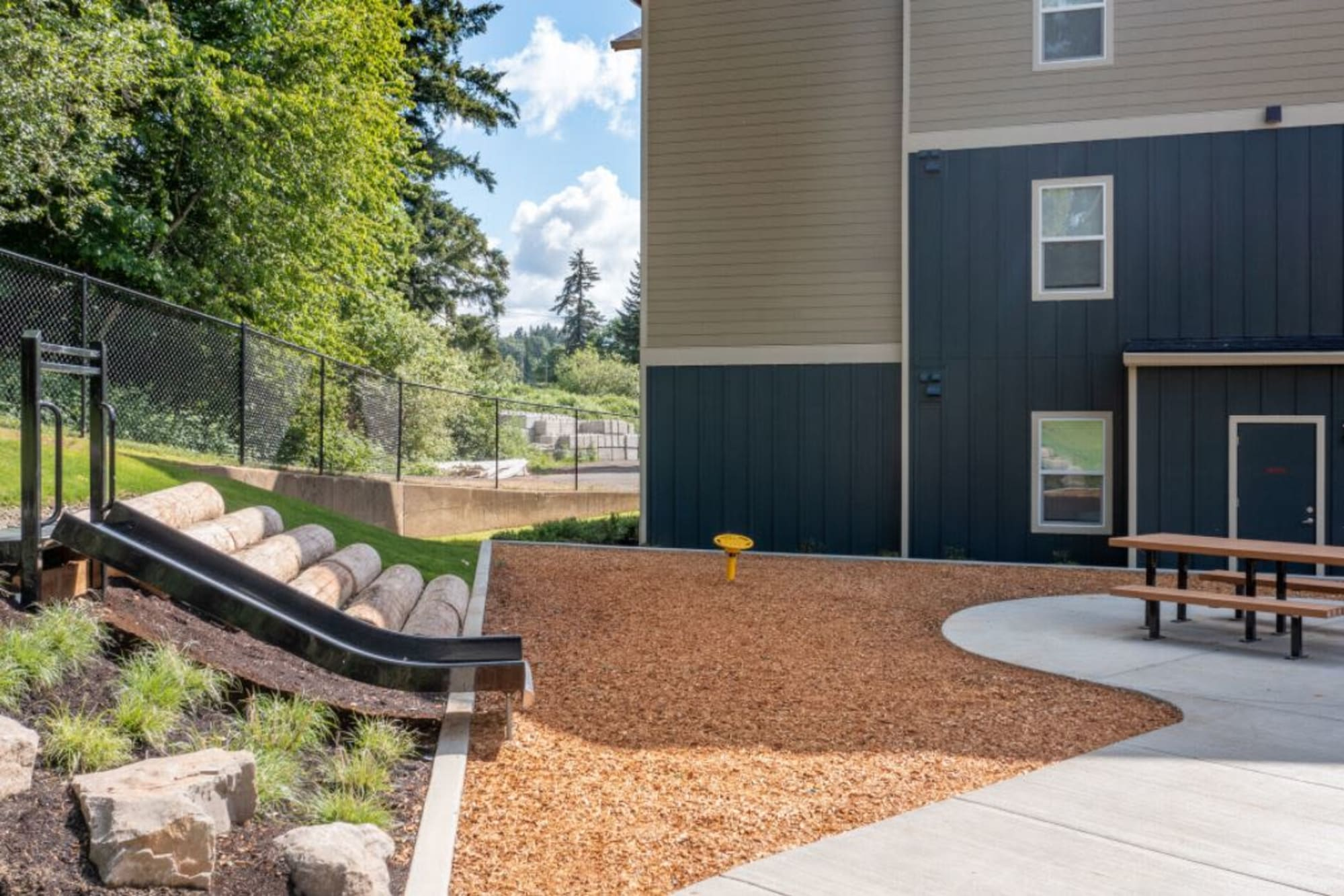 A slide and picnic table in a communal outdoors area at Haven Hills in Vancouver, Washington