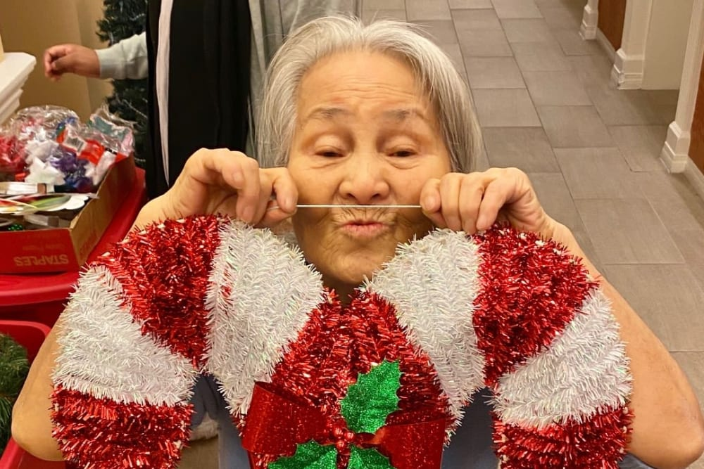 A resident having holiday fun at Merrill Gardens at First Hill in Seattle, Washington.