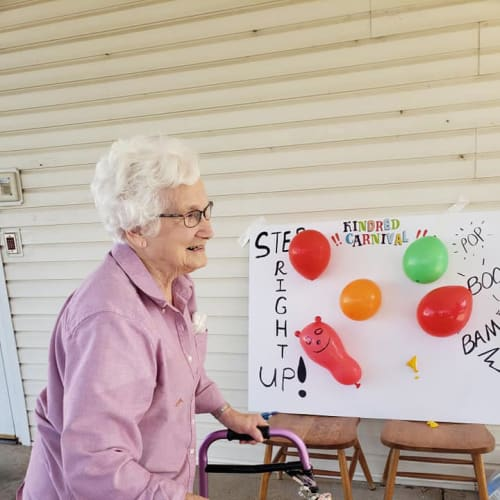 Resident with a walker playing a game at Alderbrook Village in Arkansas City, Kansas