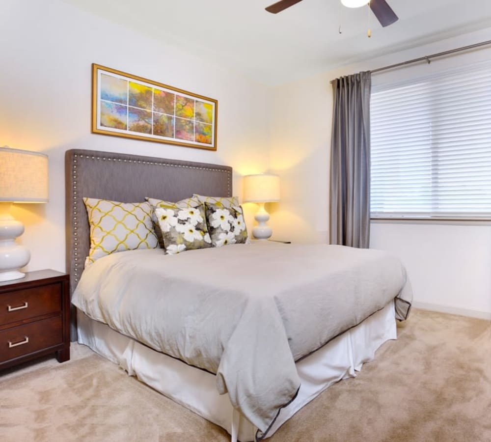 A large bedroom and window at The Parc at Greenwood Village in Greenwood Village, Colorado