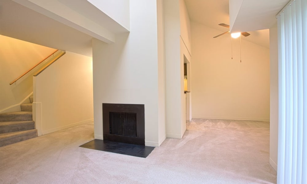 Split-level home with a fireplace and plush carpeting in a model apartment at The Chimneys of Cradlerock Apartments in Columbia, Maryland