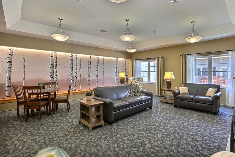 Spacious and bright resident lounge at Milestone Senior Living in Tomahawk, Wisconsin.