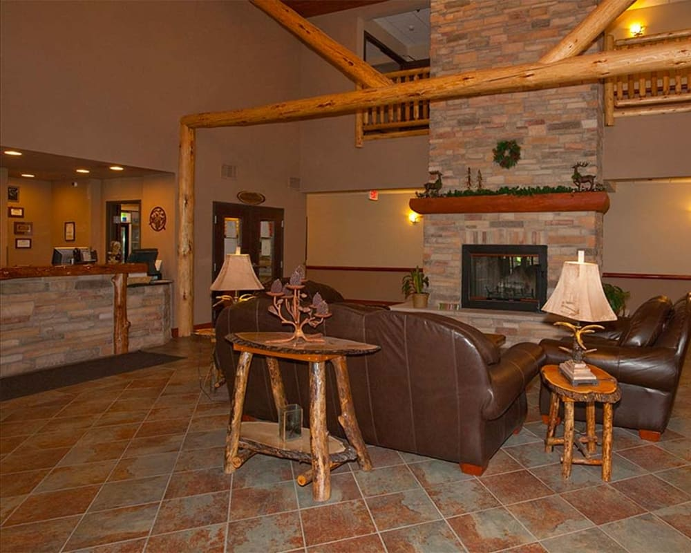 Lobby entrance with fireplace at Milestone Senior Living Eagle River in Eagle River, Wisconsin.