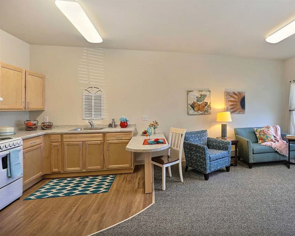 Cozy floor plans with a full living room and kitchen at Milestone Senior Living Stoughton in Stoughton, Wisconsin.