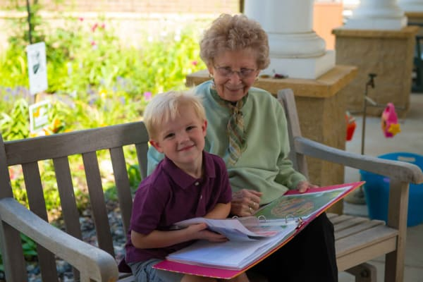 A resident and child reading together at Ebenezer Ridges Campus in Burnsville, Minnesota.