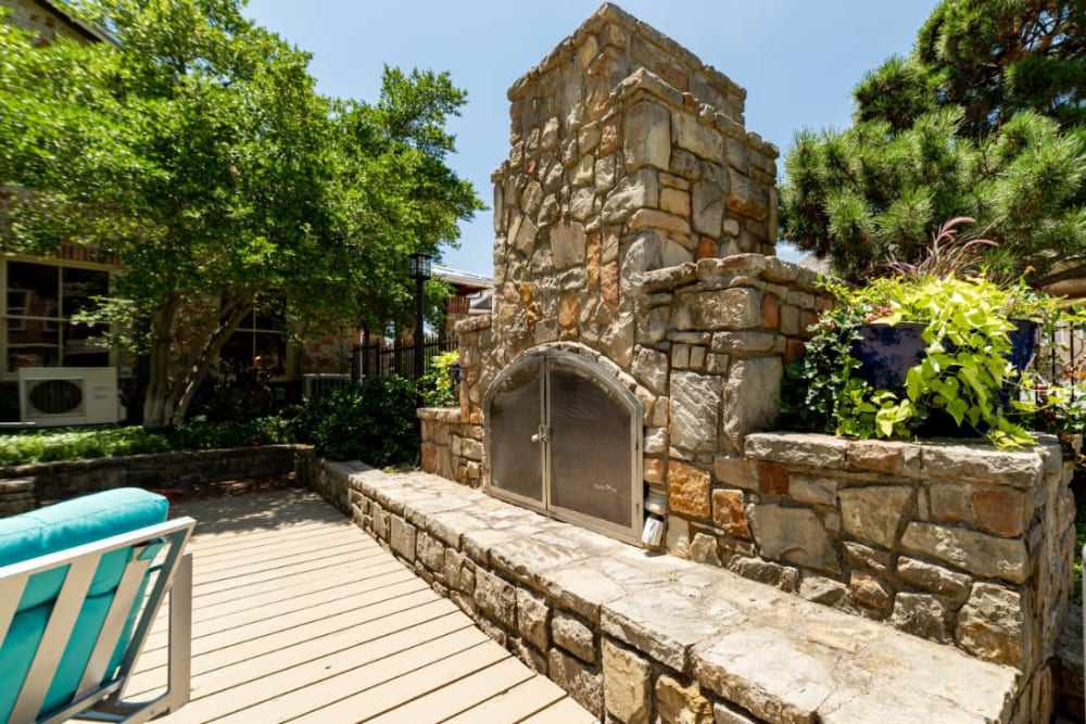 Outdoor stone fireplace at Marquis at Bellaire Ranch in Fort Worth, Texas