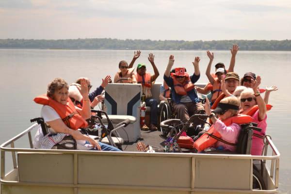 Residents on a boat near Ebenezer Ridges Campus in Burnsville, Minnesota
