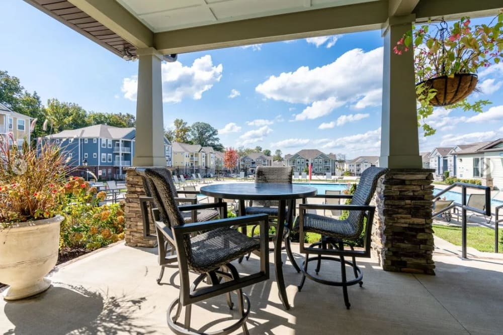 Covered seating areas outside at The Retreat at Arden Village Apartments in Columbia, Tennessee