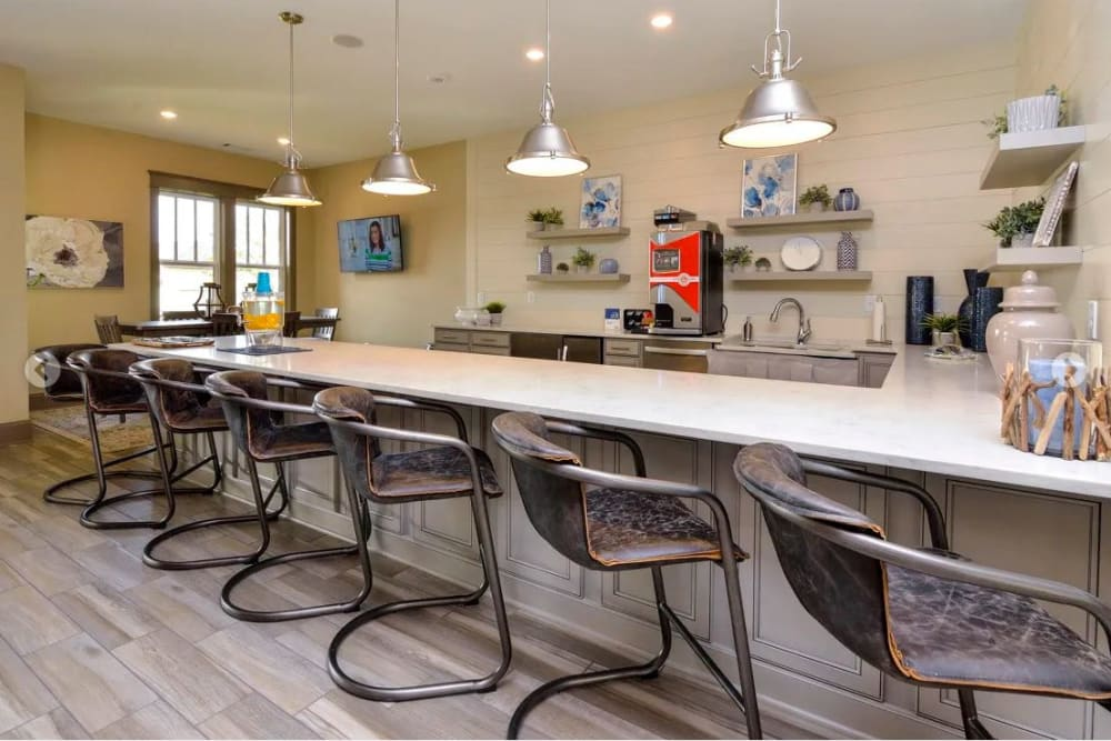 Bar seating in the clubhouse lounge at The Retreat at Arden Village Apartments in Columbia, Tennessee