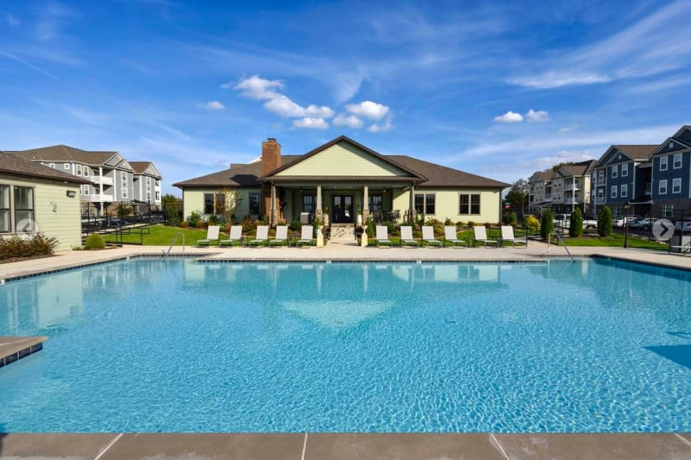 Inviting swimming pool under a blue sky at The Retreat at Arden Village Apartments in Columbia, Tennessee