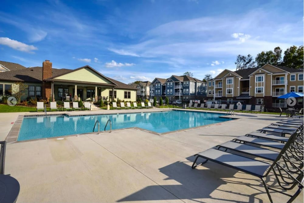 Chaise lounge chairs flanking the swimming pool at The Retreat at Arden Village Apartments in Columbia, Tennessee
