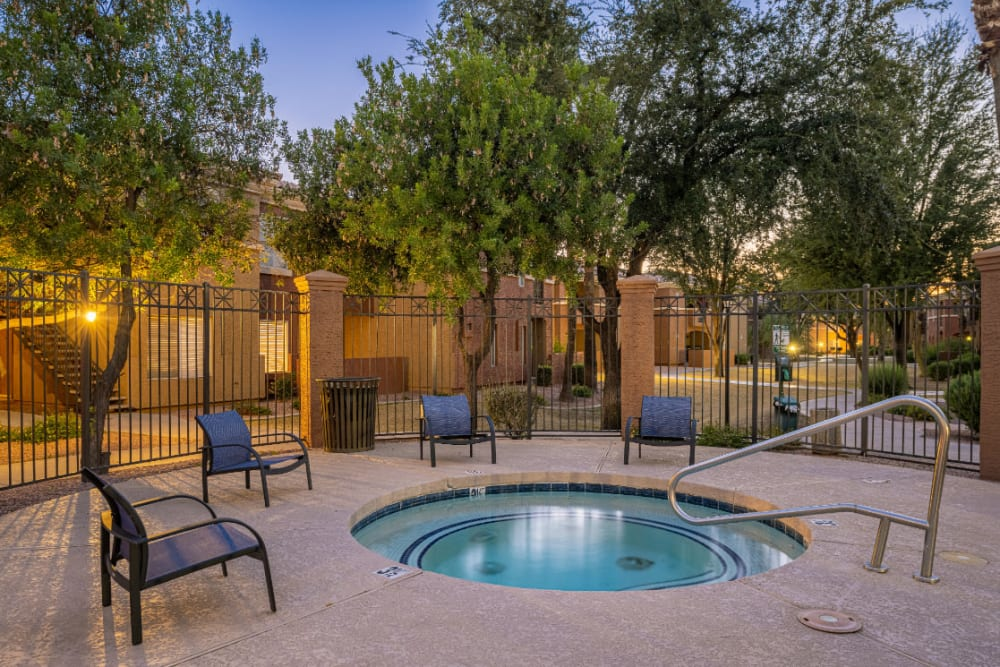 Gated hot tub with lounge chairs at Alante at the Islands in Chandler, Arizona