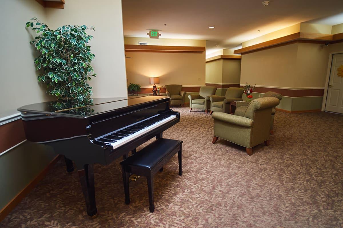 Piano in a common area at Farmington Square Eugene in Eugene, Oregon