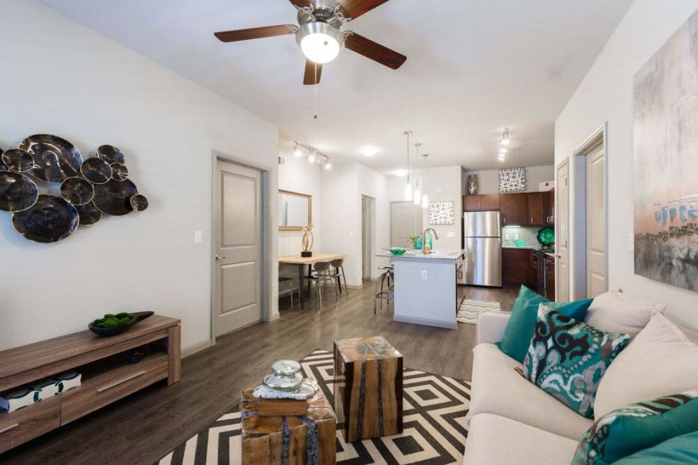 Spacious living room and kitchen at Olympus at Waterside Estates in Richmond, Texas