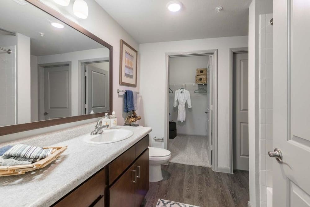 Bathroom with lots of storage space at Olympus at Waterside Estates in Richmond, Texas
