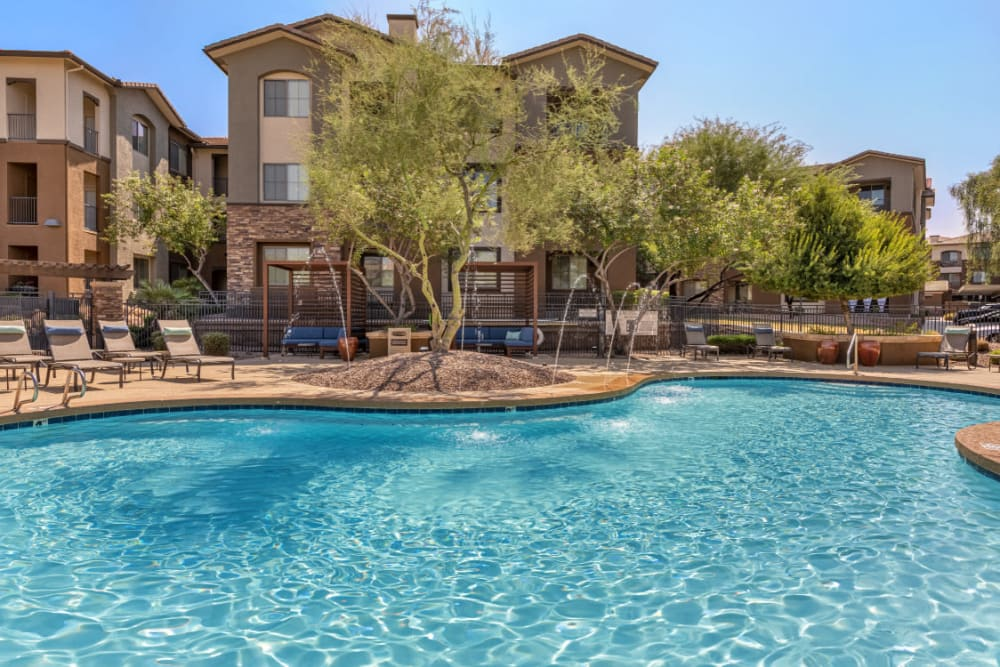 Sparkling resort style pool with water features  at Marquis at Sonoran Preserve in Phoenix, Arizona