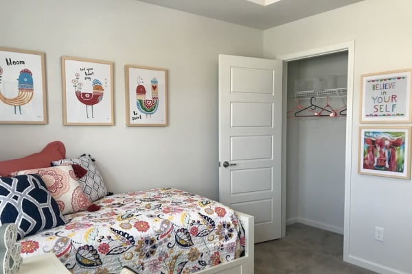 Guest bedroom with plenty of storage space at The Village at Mill Creek in Statesboro, Georgia