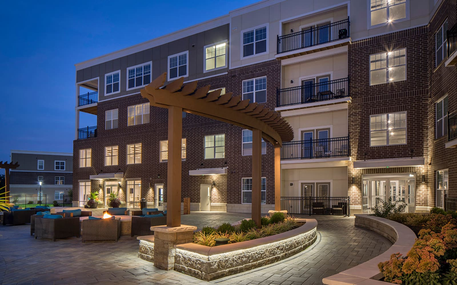 Outdoor patio with fire pit at Allure Apartments in Centerville, Ohio