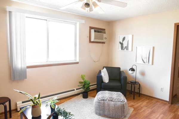Comfortable apartment living room at Campus View & Kirkwood Court in Cedar Rapids, Iowa