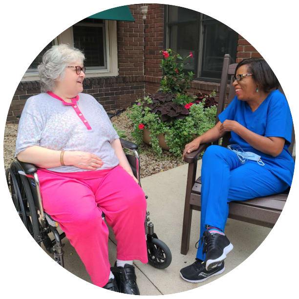 Resident laughing with an employee at Ebenezer Senior Living in Edina, Minnesota