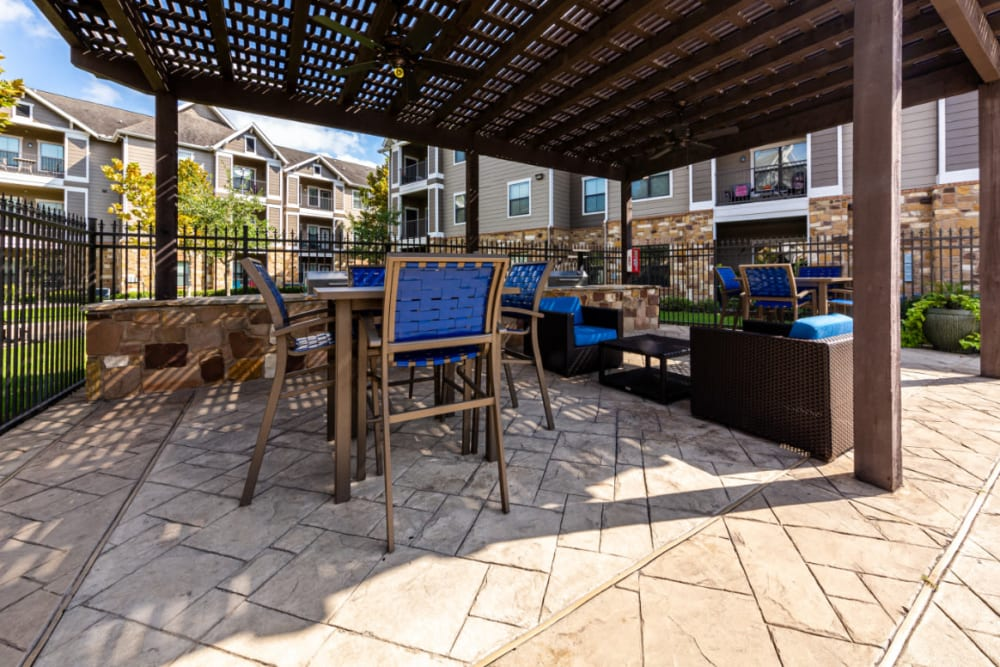 Outdoor covered BBQ and dining area at Marquis at Katy in Katy, Texas