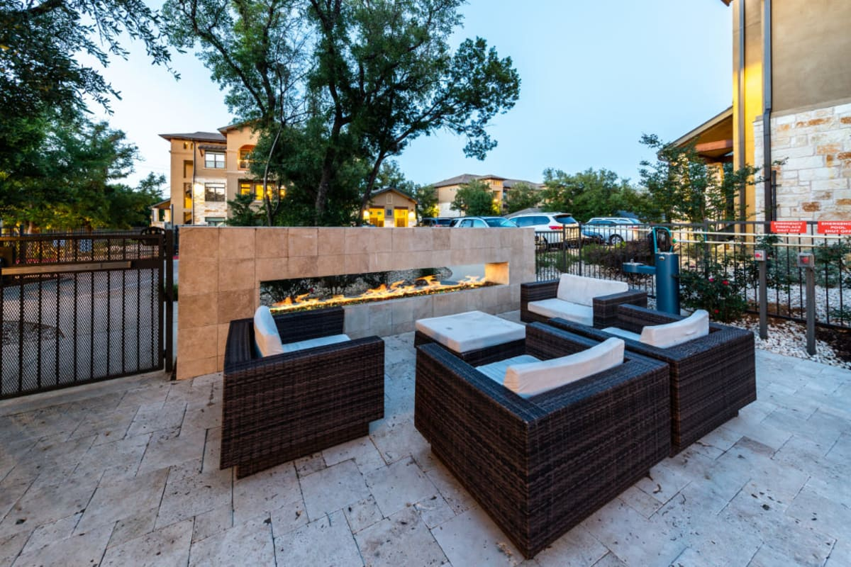 Outdoor sitting area next to standing fireplace at Austin, Texas from Marquis at Barton Trails
