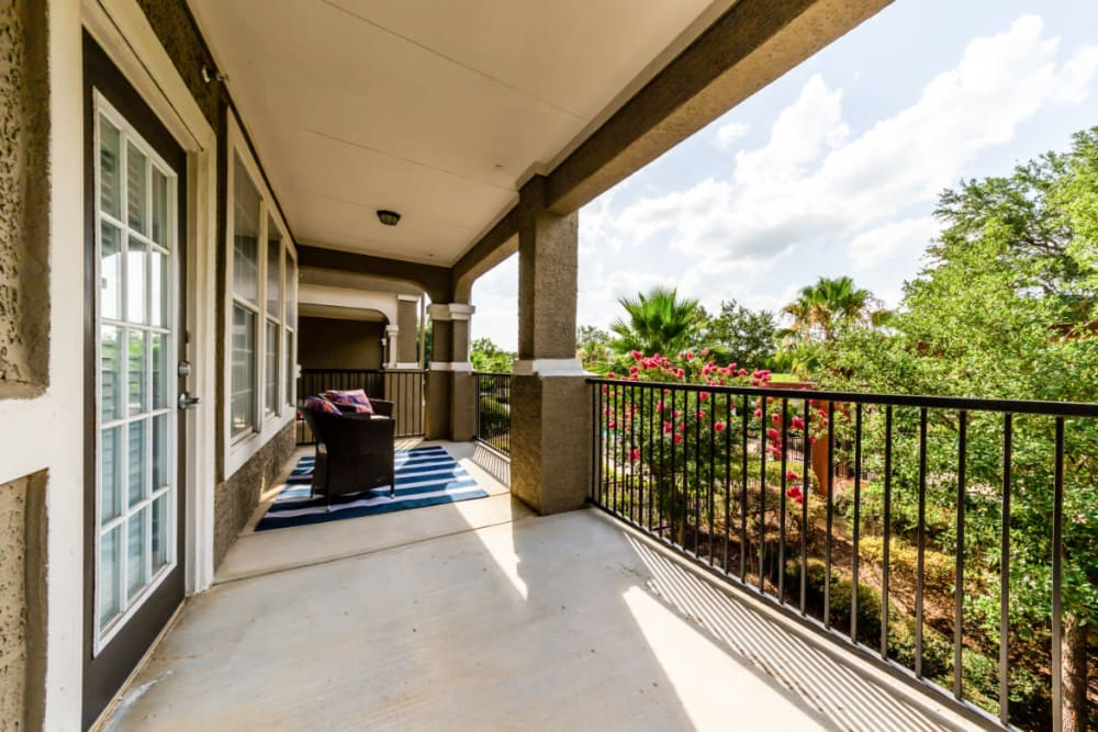Spacious private balcony overlooking tree-filled grounds at Marquis at Stone Oak in San Antonio, Texas