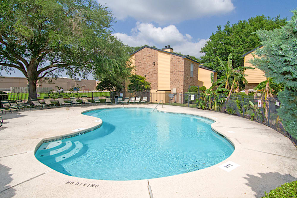 Poolside at Meadow Park Apartments in Alvin, Texas
