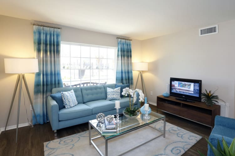 Well decorated living room with hardwood floors at Park West in Mobile, Alabama