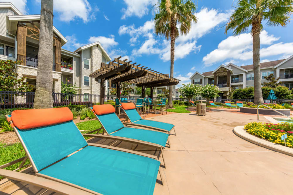 Colorful and bright lounge chairs at Marquis at Sugar Land in Sugar Land, Texas