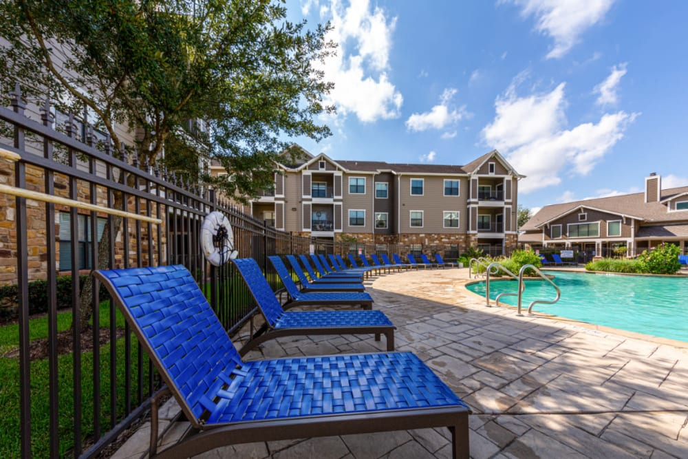 Outdoor poolside lounge area at Marquis at Katy in Katy, Texas