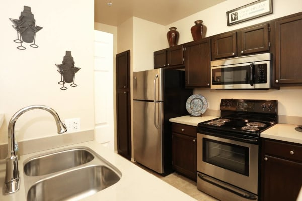 Kitchen with stainless-steel appliances at The Regents at Scottsdale in Scottsdale, Arizona