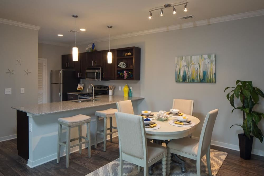 An apartment dining room at West Woods Apartments in Pensacola, Florida