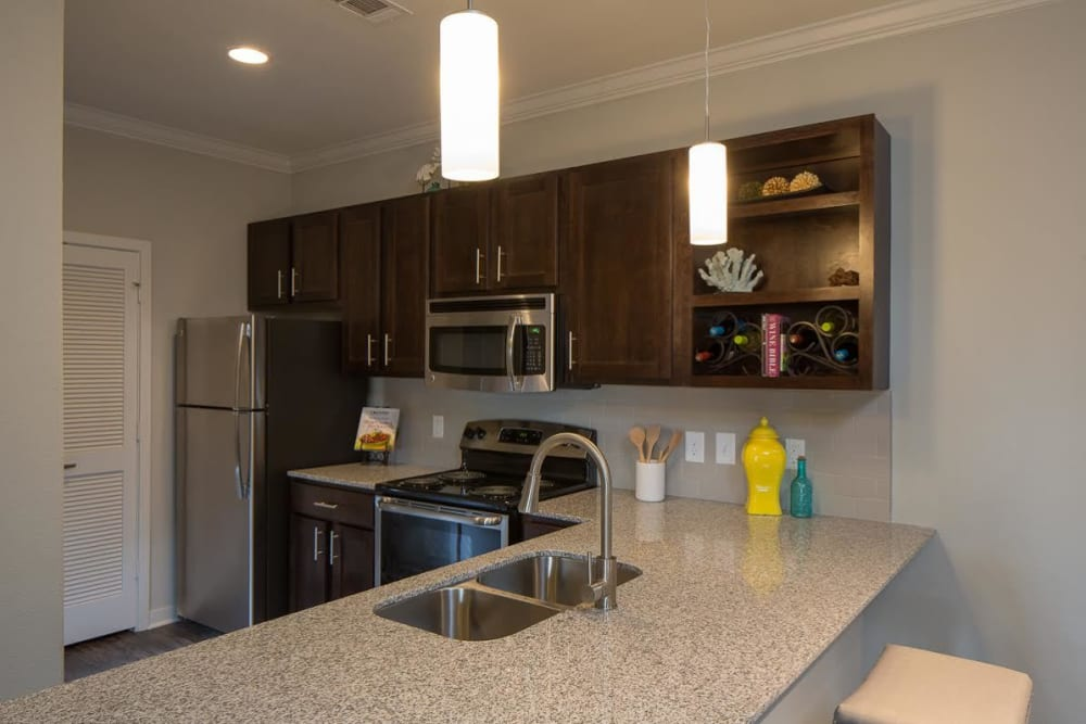 Open concept apartment kitchen at West Woods Apartments in Pensacola, Florida