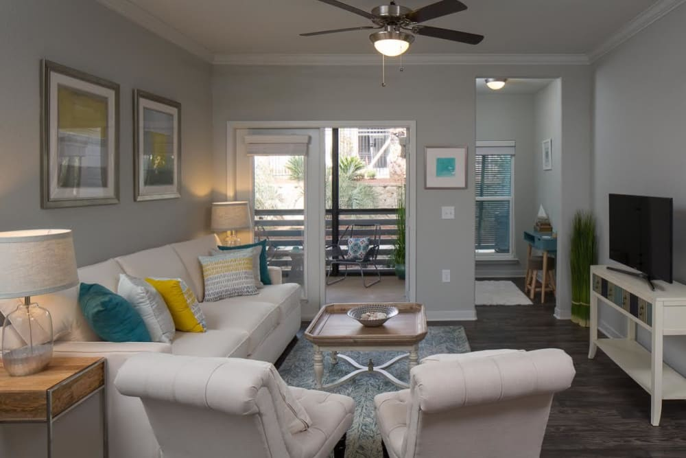 Comfortable living room at West Woods Apartments in Pensacola, Florida