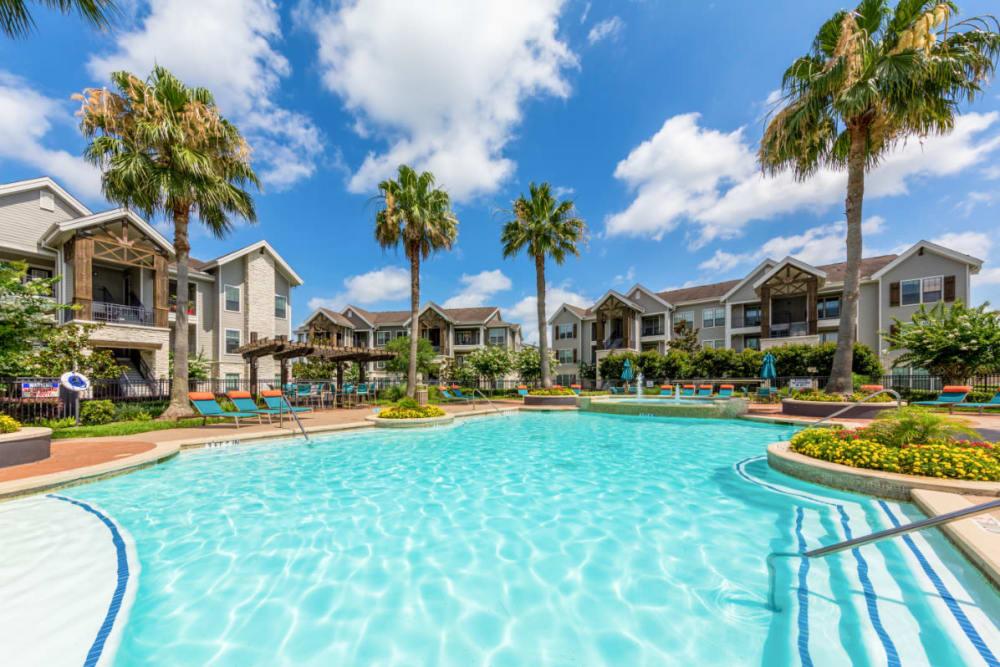 Resort style swimming pool at Marquis at Sugar Land in Sugar Land, Texas