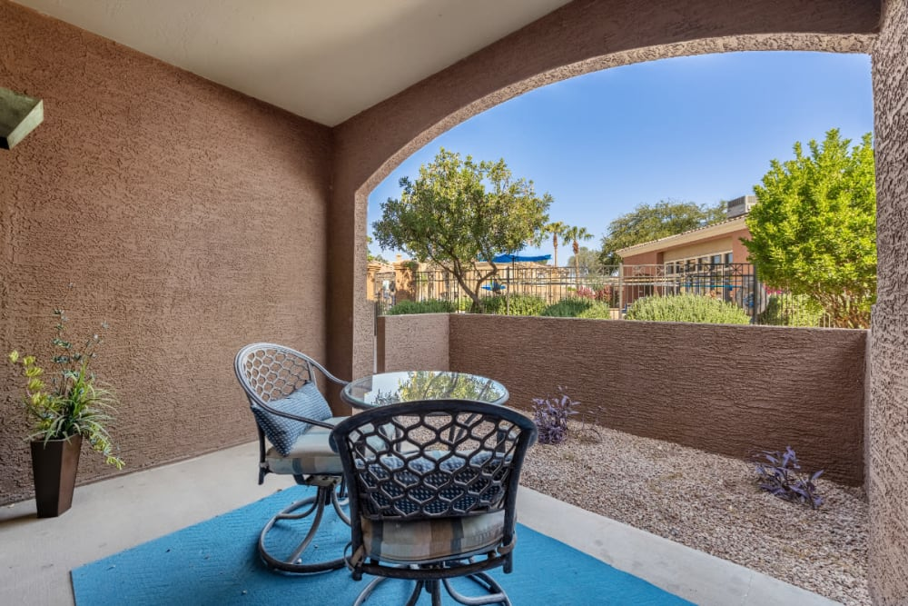 Private patio seating with plants and gravel landscape at Alante at the Islands in Chandler, Arizona