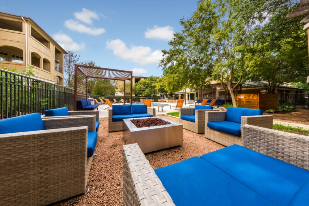 Outdoor cushioned seating with fire pit at Marquis at Barton Trails in Austin, Texas