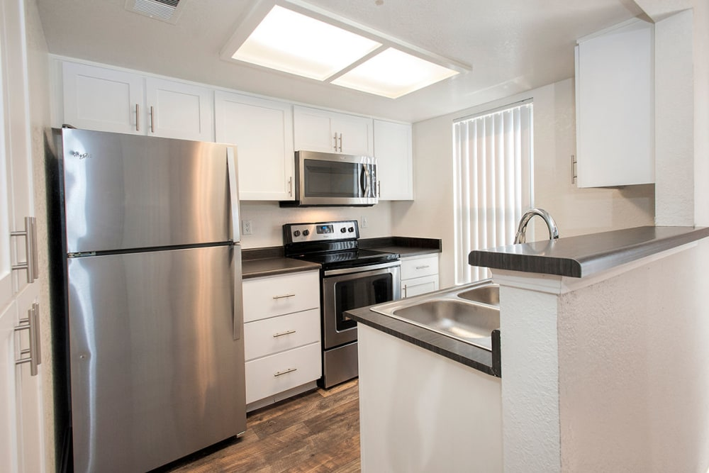 Apartment kitchen with stainless-steel appliances at Sandpiper Village Apartment Homes in Vacaville, California