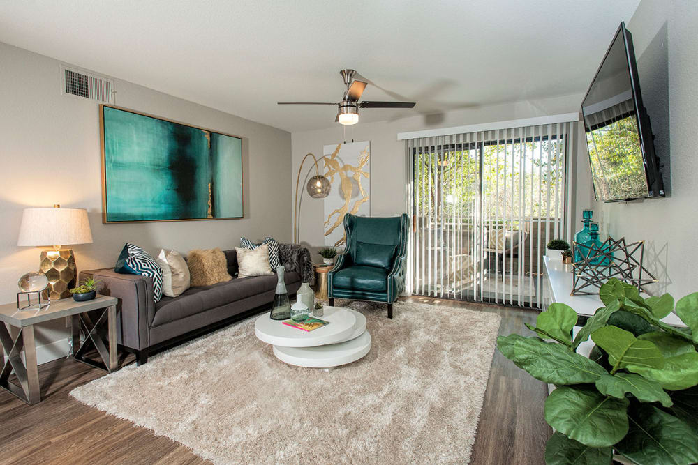 Enjoy the spacious living room at Slate Creek Apartments in Roseville, California