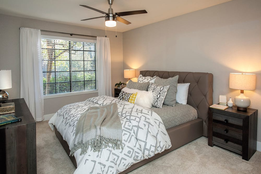 Bedroom offers a ceiling fan at Slate Creek Apartments in Roseville, California