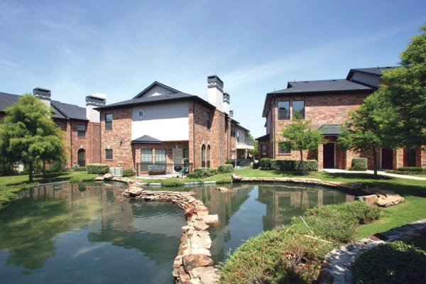 Water feature and building exterior at Villas at Parkside in Farmers Branch, Texas